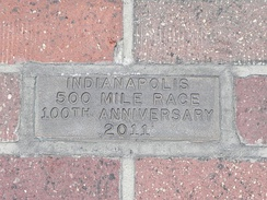 A ceremonial golden brick was installed at the start/finish line of the track to commemorate the 100th anniversary