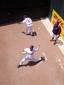 When the game goes on, a relief pitcher warms up in the bullpen. Here Aaron Fultz and Rafael Betancourt warm up in the Cleveland Indians' bullpen behind the Progressive Field fence.