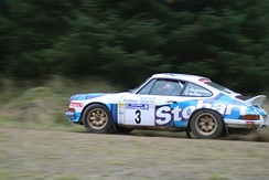 McRae's father, Jimmy, driving a Porsche 911 at the 2008 Colin McRae Forest Stages.