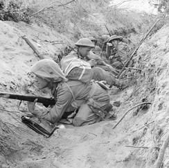 Men of 'D' Company, 1st Battalion, Green Howards, part of 13th Brigade of 5th Division, occupy a captured German communications trench during the breakout at Anzio, Italy, 22 May 1944.