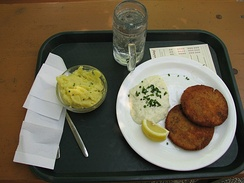 A plate of Milzwurst [de] – spleen sausage, served with potato salad, mayonnaise and lemon.