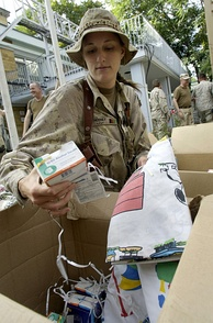 Canadian Navy Lt. Haley Mooney sorting donations sent from the United States to Camp Eggers, Kabul.