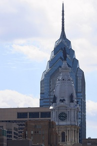 Juxtaposition of architectural styles in Center City, showing One Liberty Place and City Hall