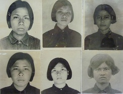 Rooms of the Tuol Sleng Genocide Museum contain thousands of photos taken by the Khmer Rouge of their victims