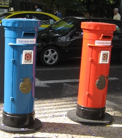 Pillar boxes on the island of Madeira, Portugal.  (1st class mail in blue and 2nd class in red)