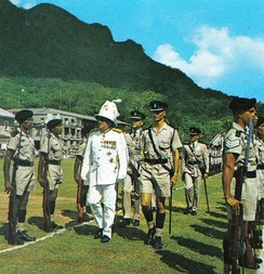 Colonial Governor of the Seychelles inspecting police guard of honour in 1972