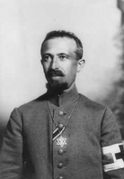 Military Field Rabbi Dr. Aaron Tänzer during World War I, with the ribbon of the Iron Cross.[83] The brassard of the red cross shows him as noncombatant. He wears the Star of David as insignium