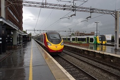 Fast and slow lines at Watford Junction: a Virgin Trains Euston-Wolverhampton service & a London Midland stopping service