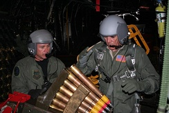 "Ermey loading ammunition for the Bofors 40 mm gun aboard a  Lockheed AC-130H ""Spectre"" Gunship in 2006"