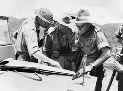 General Montagu Stopford (right) confers with other British officers after the opening of the Imphal-Kohima road.