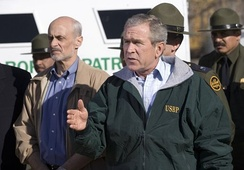 President Bush discussing border security with Homeland Security Director Michael Chertoff near El Paso, November 2005