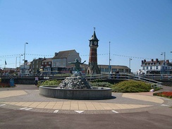 "The centre of Skegness, showing the clock tower and the ""Jolly Fisherman"" sculpture/fountain."
