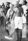 Mahatma Gandhi with Annie Besant en route to a meeting in Madras in September 1921. Earlier, in Madurai, on 21 September 1921, Gandhi had adopted the loin-cloth for the first time as a symbol of his identification with India's poor.