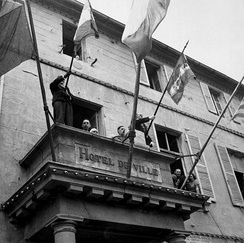 Charles de Gaulle speaks as president of interim government to the population of Cherbourg from the city hall's balcony on 20 August 1944