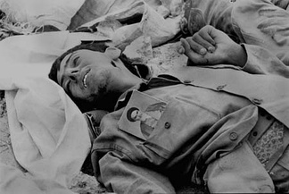Iranian soldier killed during the Iran–Iraq War with Rouhollah Khomeini's photo on his uniform
