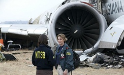 "NTSB ""go team"" members at the Asiana Airlines Flight 214 crash site"