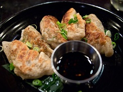 Fried dumplings served with Green Onion and sauce