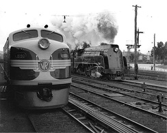 First generation diesel locomotive B60 beside one of the S class steam locomotives it replaced at Seymour in July 1952