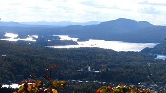 The village of Saranac Lake, bottom, with Lower Saranac Lake, above, from Baker Mountain, to the East. Lake Flower is at lower left.
