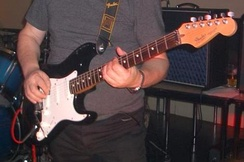 A black Fender Strat Plus from 1989 with Gold Lace Sensors and a rosewood fingerboard