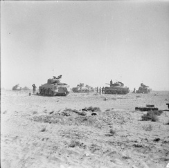 Tanks of 8th Armoured Brigade waiting just behind the forward positions near El Alamein before being called to join the battle, 27 October 1942