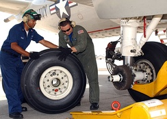 Changing a tire on a P-3C