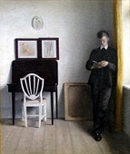Vilhelm Hammershøi (1864–1916) Interior with Young Man Reading, 1898