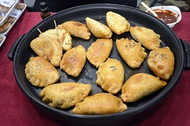 Kibinai filled with mutton and onion were introduced by Karaite ethnic minority, particularly popular in Trakai.