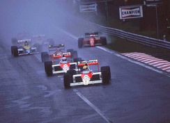 Ayrton Senna ahead of Alain Prost at the race start. Behind, Gerhard Berger, Thierry Boutsen and Nigel Mansell running wide.