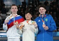 All-around victory ceremony (from left to right): Sergei Naidin (Silver), Takeru Kitazono (Gold), Diogo Soares (Bronze)