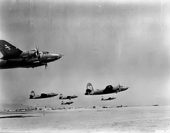 319th Bomb Group B-26 Marauders taking off en-masse from a desert base in North Africa, 1943
