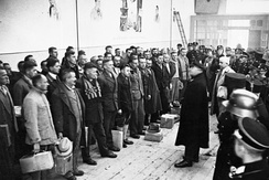 Commandant Theodor Eicke addresses 600 Dachau prisoners who were released for Christmas 1933.
