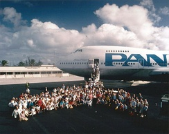 "Passengers and crew of Pan Am's China Clipper II Boeing 747 pose for a ""class picture"" at Wake Island during a 1985 trip across the Pacific to commemorate the 50th anniversary of the first China Clipper flight."