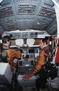 STS-1 crew in Space Shuttle Columbia's cabin. This is a view of training in 1980 in the Orbiter Processing Facility.