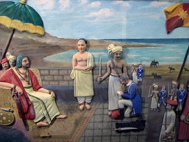 Eustachius De Lannoy of the Dutch East India Company surrenders to Maharaja Marthanda Varma of the Indian Kingdom of Travancore after the Battle of Colachel. (Depiction at Padmanabhapuram Palace)