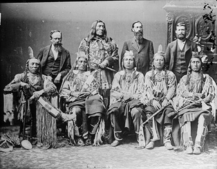 Delegation of important Crow chiefs, 1880. From left to right: Old Crow, Medicine Crow, Long Elk, Plenty Coups, and Pretty Eagle.