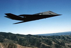 "An F-117A Nighthawk Stealth fighter from the 49th Fighter Wing, 9th Fighter Squadron ""Iron Knights,"" from Holloman AFB, New Mexico, flies a training mission over the New Mexico desert"