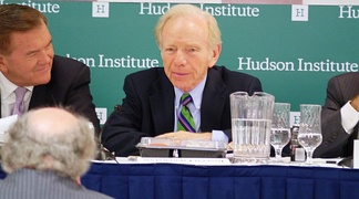 Lieberman addresses with former Secretary of Homeland Security Tom Ridge of the Blue Ribbon Study Panel on Biodefense at Hudson Institute in 2015