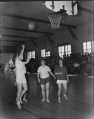 A basketball game between the Heart Mountain and Powell High School girls teams, Wyoming, March 1944