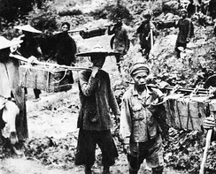 Soldiers and civilians took supplies south on the Ho Chi Minh trail (1959)