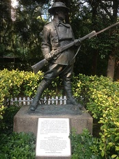 Statue of an anonymous World War I soldier from statuary collection of Eu Tong Sen.[2] Also visible is the Battle of Hong Kong memorial plaque dedicated to all the defenders of Hong Kong in December 1941 through John Robert Osborn