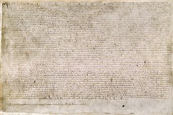"The Magna Carta (originally known as the Charter of Liberties) of 1215, written in iron gall ink on parchment in medieval Latin, using standard abbreviations of the period. This document is held at the British Library and is identified as ""British Library Cotton MS Augustus II.106""."