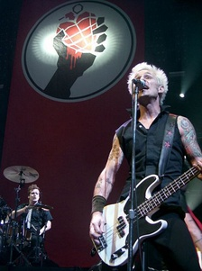 Tré Cool (bottom left) and Mike Dirnt (right) performing on July 27, 2005.