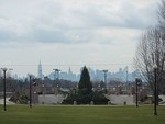 A view of the New York City skyline from the Queens College quad.