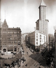 Pioneer Square in 1917 featuring the Smith Tower, the Seattle Hotel and to the left the Pioneer Building