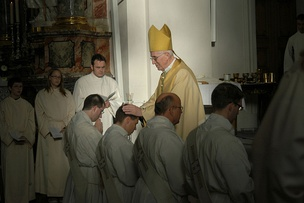 Laying on of hands during a priestly ordination catholic, in Germany