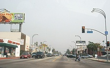 Victory Boulevard in Van Nuys, lined with low-rise commercial establishments, is typical of the broad, straight boulevards in the San Fernando Valley. Photo, 2002.