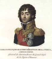 Painting shows a curly haired man wearing a blue military uniform with gold epaulettes, gold lace and a red sash.