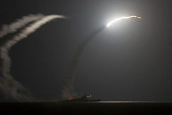Tomahawk missiles being fired from USS Philippine Sea and USS Arleigh Burke at IS targets in Syria