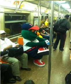 Wally 'Behind Enemy Lines' riding the Subway in NYC on a trip to the MLB FanCave